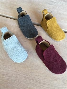 b0dec425937f Haflinger hjemmesko til baby i uld. Sutsko i uld til børn.